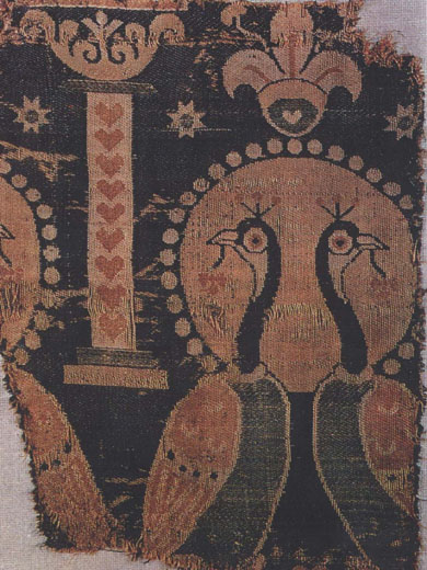 Fragment of Persian silk textile with fleur-de-lys motif in the Treasury of Aachen Cathedral. 6th century AD